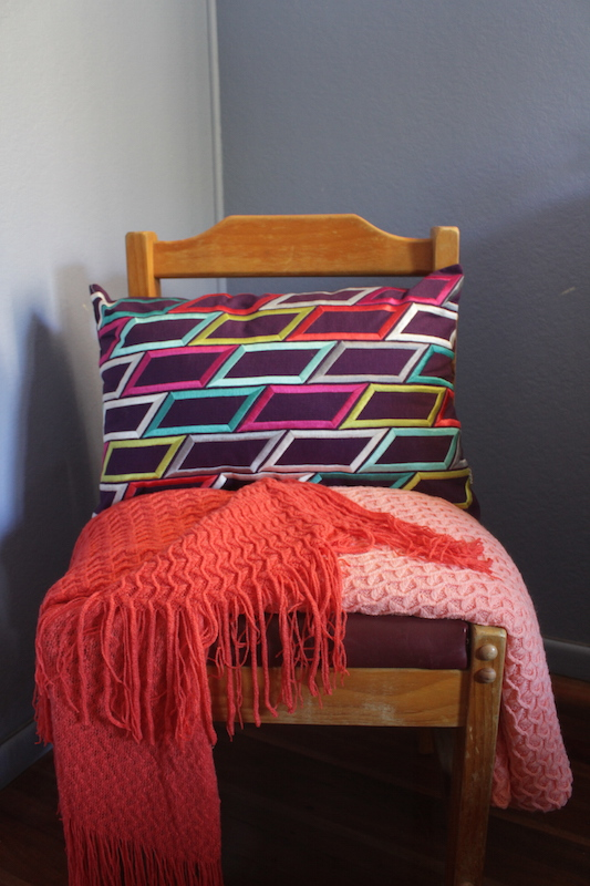 Just Bedding - style an old chair with a throw and cushion